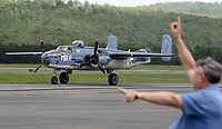NWA Democrat-Gazette/DAVID GOTTSCHALK  Russell Smith, Arkansas Air and Military Museum board member, marshalls Wednesday, April 19, 2017, a Marine B-25 after the plane landed at the Arkansas Air and Military Museum at Drake Field in Fayetteville.The museum is hosting the only airworthy Marine B-25 on the 19th and 20th. The Marine version of the B-25 is designated the PBJ. A donation at the door of $15.00 for adults and $10.00 for children under 12 includes entrance to the museum and a tour of the PBJ.
