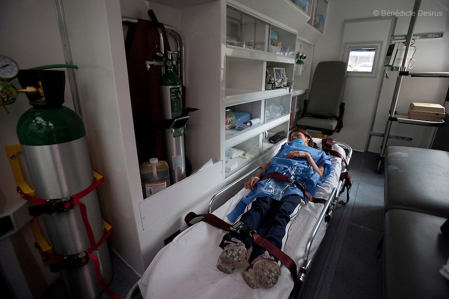 30 april  2009 - Mexico City, Mexico - After seeking help at the Mexico City Naval Hospital 9 year old Alondra Rodriguez Alfaro was hospitalized for Swine Flu. In these images she is being transported from the Naval Hospital to a more specialized hospital for treatment. She will have to wait for the test results to confirm she has Swine Flu which will take a month to come back from Atlanta. Mexico opened up its newly built national naval hospital to civilians to deal with the overwhelming number of suspected swine flu cases. Staffers wore goggles, masks and booties to protect themselves while treating patients. The high quality of care stands in stark contrast to most neighborhood hospitals in Mexico City which don't have the staff or resources to deal with the influx of new Flu cases. World health officials raised a global alert to an unprecedented level as the swine flu was blamed for more deaths in Mexico and the epidemic crossed new borders, with the first cases confirmed Tuesday in the Middle East and the Asia-Pacific region. Photo credit: Benedicte Desrus / Sipa Press