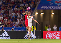 LYON,  - JULY 2: Lindsey Horan #9 heads the ball with Jill Scott #8 during a game between England and USWNT at Stade de Lyon on July 2, 2019 in Lyon, France.