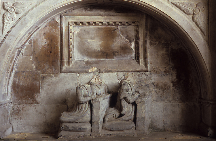 Stone tomb of high society 16th-century couple with sculptures of them kneeling but with their heads broken off in Reformation Norfolk UK