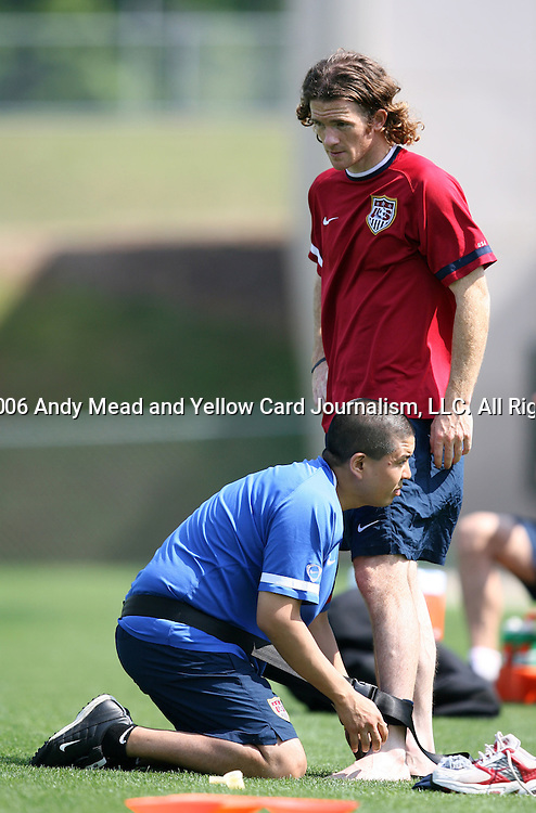 John O'Brien (r) has his ankle wrapped by Jim Hashimoto (below) on Sunday, May 14th, 2006 at SAS Soccer Park in Cary, North Carolina. The United States Men's National Soccer Team held a training session as part of their preparations for the upcoming 2006 FIFA World Cup Finals being held in Germany.