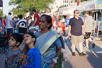 NWA Democrat-Gazette/CHARLIE KAIJO Geetha Mohankumar of Bentonville (center right) embraces Advaith Raj, 8, also pictured with Aditya Raj, 8, (left) during the First Friday event, Friday, August 3, 2018 at the Bentonville Square in Bentonville.
