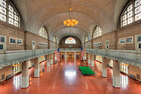 A view of the Ellis Island Registry Room (the Great Hall) from the 2nd floor balcony inside the Ellis Island Immigration Museum.  The Museum is part of the Statue of Liberty National Monument.