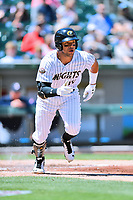 Charlotte Knights second baseman Yoan Moncada (10) runs to first base during a game against the  Gwinnett Braves at BB&T Ballpark on May 7, 2017 in Charlotte, North Carolina. The Knights defeated the Braves 7-1. (Tony Farlow/Four Seam Images)