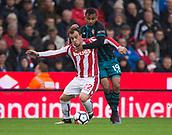 30th September, bet365 Stadium, Stoke-on-Trent, England; EPL Premier League football, Stoke City versus Southampton; Stoke City's Xherdan Shaqiri is tackled by Southampton's Sofiane Boufal