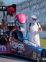 Aug 18, 2019; Brainerd, MN, USA; A fan in an abominable snowman costume alongside the car of NHRA top fuel driver Leah Pritchett during the Lucas Oil Nationals at Brainerd International Raceway. Mandatory Credit: Mark J. Rebilas-USA TODAY Sports