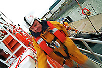 Royal National Lifeboat Institution crew boarding this Severn class, all weather type lifeboat to go out on a rescue. This image may only be used to portray the subject in a positive manner..©shoutpictures.com..john@shoutpictures.com