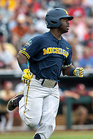 Michigan Wolverines second baseman Ako Thomas (4) runs to first base during Game 6 of the NCAA College World Series against the Florida State Seminoles on June 17, 2019 at TD Ameritrade Park in Omaha, Nebraska. Michigan defeated Florida State 2-0. (Andrew Woolley/Four Seam Images)