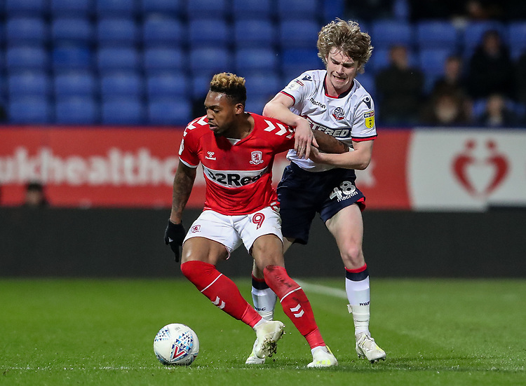Bolton Wanderers' Luca Connell competing with Middlesbrough's Britt Assombalonga <br /> <br /> Photographer Andrew Kearns/CameraSport<br /> <br /> The EFL Sky Bet Championship - Bolton Wanderers v Middlesbrough -Tuesday 9th April 2019 - University of Bolton Stadium - Bolton<br /> <br /> World Copyright © 2019 CameraSport. All rights reserved. 43 Linden Ave. Countesthorpe. Leicester. England. LE8 5PG - Tel: +44 (0) 116 277 4147 - admin@camerasport.com - www.camerasport.com