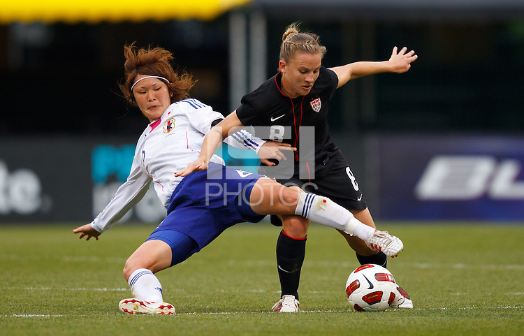 14 MAY 2011: Japan National team Mizuho Sakaguchi tries to tackle the ball from USA Women's National Team forward Amy Rodriguez (8) during the International Friendly soccer match between Japan WNT vs USA WNT at Crew Stadium in Columbus, Ohio.