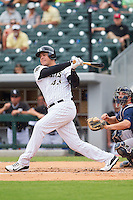Avisail Garcia (43) of the Charlotte Knights follows through on his swing against the Pawtucket Red Sox at BB&T Ballpark on August 8, 2014 in Charlotte, North Carolina.  The Red Sox defeated the Knights  11-8.  (Brian Westerholt/Four Seam Images)