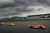 Feb 25, 2007; Fontana, CA, USA; Nascar Nextel Cup Series driver Tony Stewart (20) leads Kevin Harvick (29) and Juan Pablo Montoya (42) during the Auto Club 500 at California Speedway. Mandatory Credit: Mark J. Rebilas