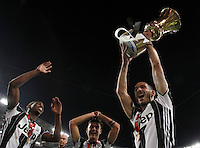 Calcio, finale Tim Cup: Milan vs Juventus. Roma, stadio Olimpico, 21 maggio 2016.<br /> Juventus' Leonardo Bonucci, right, flanked by teammates Paulo Dybala, center, and Paul Pogba, holds up the trophy at the end of the Italian Cup final football match between AC Milan and Juventus at Rome's Olympic stadium, 21 May 2016. Juventus won 1-0 in the extra time.<br /> UPDATE IMAGES PRESS/Isabella Bonotto