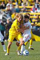 27 MARCH 2010:  Steven Lenhart of the Columbus Crew (32) and Martin Saric of Toronto FC (25) during the Toronto FC at Columbus Crew MLS game in Columbus, Ohio on March 27, 2010.