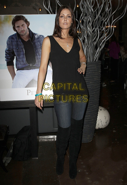 SUMMER ALTICE .Relief Fund Pre-Oscar gifting suite Hosted by Silver Spoon Inc held At Interior Illusion, West Hollywood, California, USA, 4th March 2010..full length black otk over the knee high boots hand on hip vest top jeans .CAP/ADM/KB.©Kevan Brooks/AdMedia/Capital Pictures.