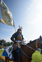 Horseback participant travelling to the Somanomaoi Festival in the morning, Minami-soma City, Fukushima Prefecture, Japan, July 28, 2013. During the four-day-long Somanomaoi Festival members of old samurai families ride horseback through the town in traditional armour.  They also take conduct ceremonies at local shrines, take part in horse races, and compete on horseback to catch a flag launched into the air by fireworks.