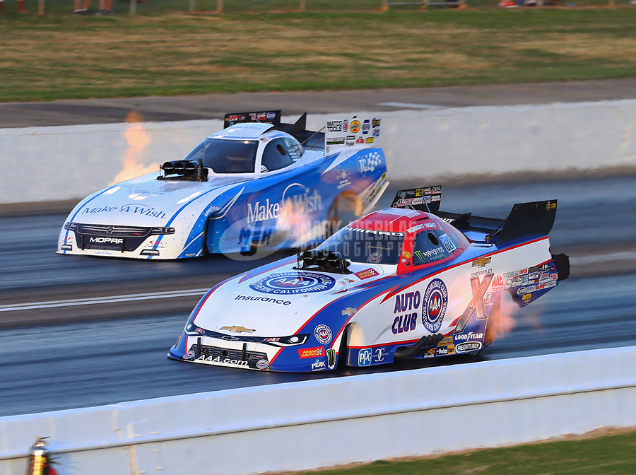 May 4, 2018; Commerce, GA, USA; NHRA funny car driver Robert Hight (near) races alongside Tommy Johnson Jr during qualifying for the Southern Nationals at Atlanta Dragway. Mandatory Credit: Mark J. Rebilas-USA TODAY Sports