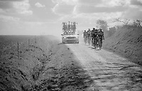 a group behind is caught in the dust of overtaking team cars<br /> <br /> 33th Tro Bro L&eacute;on 2016