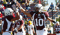Gary Nova #10 and Frank Falaice #7 of Don Bosco celebrate after Nova ran in for a touchdown against St Ignatius during the game at Harding Stadium in Steubenville, OH on September 25, 2010. ..Jared Wickerham.
