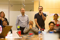 San Francisco, CA - Tuesday, July 1, 2014:  Byron Varga (center) reacted to a play just before halftime. In downtown San Francisco employees filled the boardroom at Kilpatrick Townsend & Stockton, LLP to watch the USA vs. Belgium World Cup Round of 16 game.