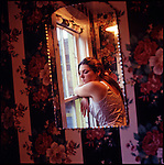 Woman reflected in bathroom mirror
