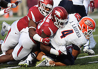 NWA Democrat-Gazette/ANDY SHUPE<br /> Arkansas' Dre Greenlaw (center) tackles University of Texas at El Paso's Jeremiah Laufasa (4) Saturday, Sept. 5, 2015, during the fourth quarter of play in Razorback Stadium in Fayetteville. Visit nwadg.com/photos to see more from the game.