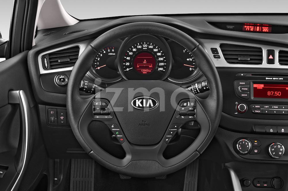 Car pictures of steering wheel view of a 2014 KIA cee'd Access 5 Door Wagon 2WD Steering Wheel