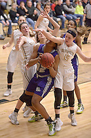NWA Democrat-Gazette/BEN GOFF @NWABENGOFF<br /> Abby Roberts (15) of Bentonville blocks a shot by Jasmine Franklin of Fayetteville on Friday Feb. 26, 2016 during the game in Bentonville's Tiger Arena.