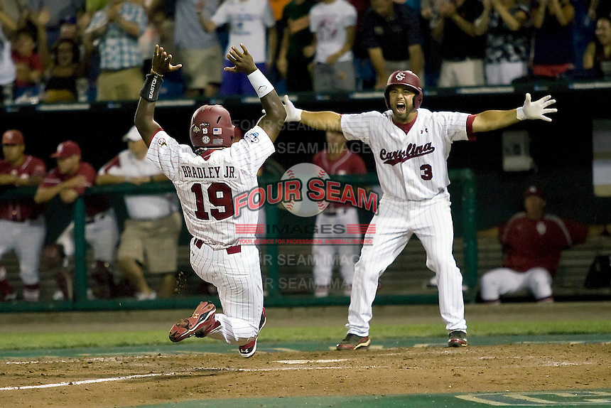 South Carolina's Jackie Bradley Jr. scores the winning run as Adrian Morales celebrates in Game 10 of the NCAA Division One Men's College World Series on June 24th, 2010 at Johnny Rosenblatt Stadium in Omaha, Nebraska.  (Photo by Andrew Woolley / Four Seam Images)