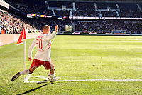 Joel Lindpere (20) of the New York Red Bulls takes a corner kick during the 1st leg of the Major League Soccer (MLS) Western Conference Semifinals against the Los Angeles Galaxy at Red Bull Arena in Harrison, NJ, on October 30, 2011.