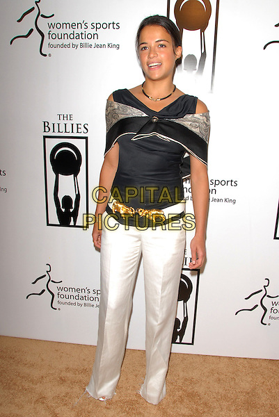 MICHELLE RODRIGUEZ.Attends The Billies held at The Beverly Hilton Hotel in Beverly Hills, California on .April 11th, 2007.full length white trousers black top belt gold elephants wrap shawl .CAP/DVS.©Debbie VanStory/Capital Pictures