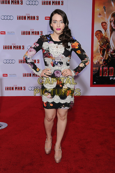 """Kat Dennings.The Los Angeles Premiere of """"Iron Man 3"""" at El Capitan Theatre in Hollywood, California, USA..April 24th, 2013.full length black white red orange floral print lace dress beige shoes platform hands on hips.CAP/ROT/TM.©Tony Michaels/Roth Stock/Capital Pictures"""