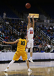 Bishop Gorman's Noah Taitz shoots over Bishop Manogue defender Kolton Frugoli during the 4A NIAA state basketball championship game in Reno, Nev., on Friday, Feb. 23, 2018. Gorman won 62-41. Cathleen Allison/Las Vegas Review-Journal