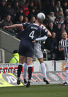 Grant Munro and Steven Thompson compete in the air in the St Mirren v Ross County Clydesdale Bank Scottish Premier League match played at St Mirren Park, Paisley on 19.1.13.