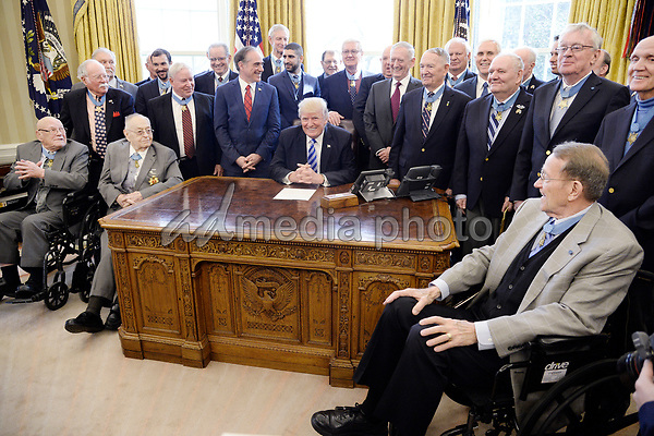 United States President Donald Trump meets with thirty Medal of Honor recipients in the Oval Office of  the White House on March 24, 2017 in Washington, DC. The thirty recipients are about 1/3 of the total living persons who have received the medal. Photo Credit: Olivier Douliery/CNP/AdMedia