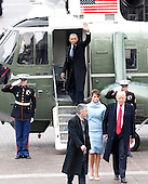 Former President of the United States Barack Obama waves from a Marine One helicopter as newly elected United States President Donald Trump walks with wife Melania Trump back to the Capitol Building after Trump is sworn in at the 58th Presidential Inauguration on Capitol Hill in Washington, D.C. on January 20, 2017.  <br /> Credit: John Angelillo / Pool via CNP