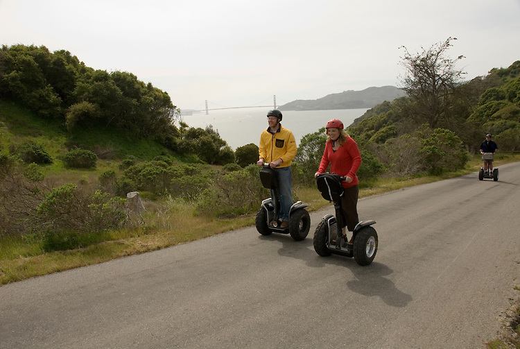Couple on Segways, each on a Segway, on Angel Island State Park in San Francisco Bay, California, CA. Model released..Photo camari218-70424..Photo copyright Lee Foster, www.fostertravel.com, 510-549-2202, lee@fostertravel.com.