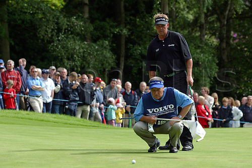 30 May 2004: Darren Clarke (NI) lines up his putt on the 14th green during the final round of The Volvo PGA Championship, Wentworth, England. Photo: Glyn Kirk/Actionplus...040530 golf golfer player