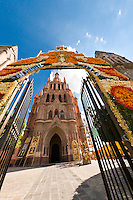 The Church of St. Michael the Archangel decorated with marigolds for La Alborada (birthday of San Miguel the Archangel, the patron saint of the town), Plaza Principal, San Miguel de Allende, Guanajuato state, Mexico