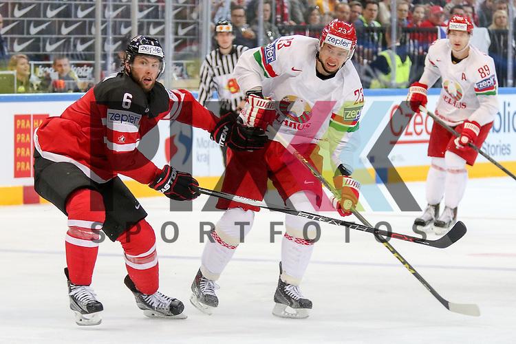 Belarus Stas, Andrei (Nr.23)(CSKA Moscow) mit einem Schuss vorbei an Canadas Muzzin, Jake (Nr.6)  im Spiel IIHF WC15 Canada vs. Belarus.<br /> <br /> Foto &copy; P-I-X.org *** Foto ist honorarpflichtig! *** Auf Anfrage in hoeherer Qualitaet/Aufloesung. Belegexemplar erbeten. Veroeffentlichung ausschliesslich fuer journalistisch-publizistische Zwecke. For editorial use only.