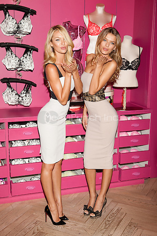 Victoria's Secret supermodels Candice Swanepoel and Bregje Heinen celebrate the New Body by Victoria Collection in SoHo, New York City. July 31, 2012 © Diego Corredor/MediaPunch Inc.