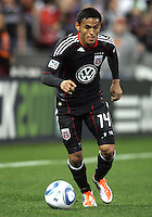 Andy Najar#14 of D.C. United during the opening match of the 2011 season against the Columbus Crew at RFK Stadium, in Washington D.C. on March 19 2011.D.C. United won 3-1.
