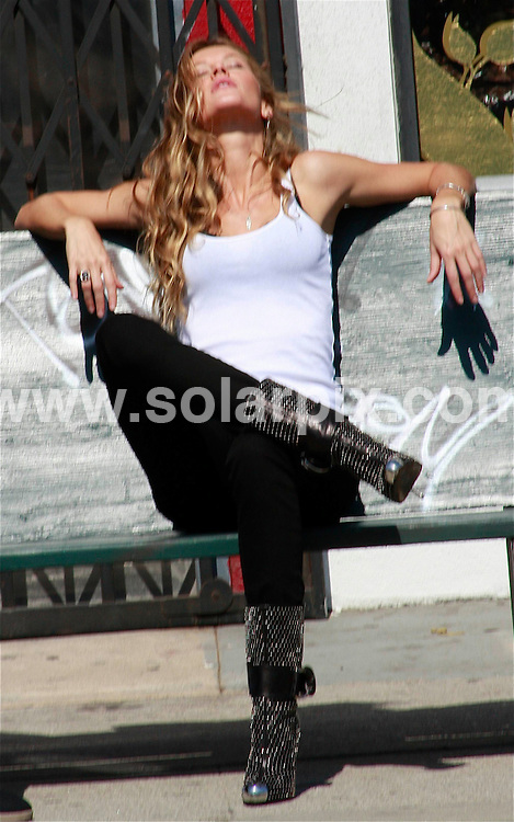 **ALL ROUND PICTURES FROM SOLARPIX.COM**.**WORLDWIDE SYNDICATION RIGHTS EXCEPT FOR USA, AUSTRALIA & GERMANY**.The Brazilian top model Gisele Bundchen films a sexy cameo on Melrose Avenue for alternative rock band Blackcowboy's new song 'Come On' in West Hollywood in California in the USA...JOB REF:7563-LAS       DATE:09_10_08.**MUST CREDIT SOLARPIX.COM OR DOUBLE FEE WILL BE CHARGED* *UNDER NO CIRCUMSTANCES IS THIS IMAGE TO BE REPRODUCED FOR ANY ONLINE EDITION WITHOUT PRIOR PERMISSION*