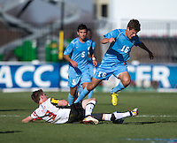 Alex Shinsky (9) of Maryland tackles the ball away from Rob Lovejoy (16) of North Carolina during the game at the Maryland SoccerPlex in Germantown, MD. Maryland defeated North Carolina, 2-1,  to win the ACC men's soccer tournament.