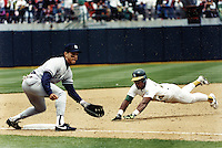 Rickey Henderson dives into 3rd base against the Yankee's to steal #938 to tie Lou Brock for the major league lead in stolden bases. (copyright 1991 Ron Riesterer)