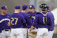 Washington Huskies pitcher Troy Rallings (28) talks with his teammates on the mound during the NCAA baseball game against the Michigan Wolverines on February 16, 2014 at Bobcat Ballpark in San Marcos, Texas. The game went eight innings, before travel curfew ended the contest in a 7-7 tie. (Andrew Woolley/Four Seam Images)