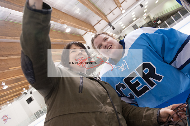 From left, Chugiak Eagle River assistant coach O'Hara Shipe and senior goalie Shelby Skandovitch take a selfie for Senior Night at Ben Boeke Arena Monday, January 25th, 2016.  Photo for the Star by Michael Dinneen