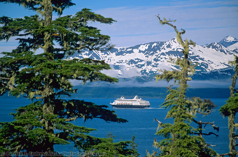 Holland America cruise boat Statendam, passes through Port Wells in Prince William Sound, Alaska. Chugach mountains in the distance.