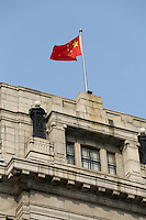 A Chinese national flag flying over a building on the Bund.<br />