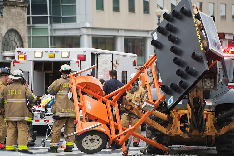 UNITED STATES - JUNE 10: A worker is loaded into an ambulance after a construction accident on the northwest corner of North Capitol St., and Massachusetts Ave. Another worker said the man suffered a leg injury. (Photo By Tom Williams/CQ Roll Call)